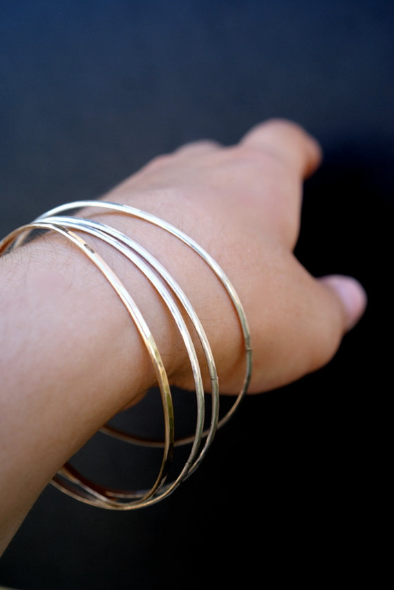 gold bangle set on hand