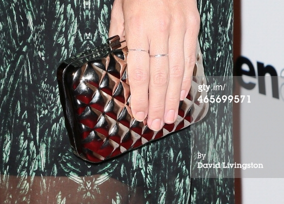 close up of hannahnaomi stacking rings at movie premiere